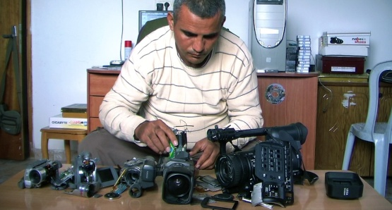 Co-director Emad Burnat with his five broken cameras.