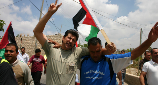 Adeeb & Phil participate in a protest against the Israeli settlements.