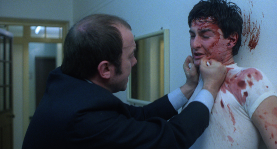 John Judd as Sands, one of the screws, and a bloodied John Blundell as Pongo in Alan Clarke's SCUM