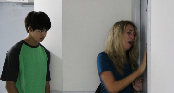 Debbie (Daisy Haggard) and Josh (Luca Oriel) at the doors of Nikki's apartment.