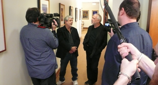 George Lucas and Drew Struzan discuss art at Lucasfilm during the filming of DREW: THE MAN BEHIND THE POSTER.