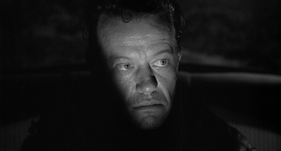 William Talman's Emmett Myers emerges from the shadows in Ida Lupino's THE HITCH-HIKER.